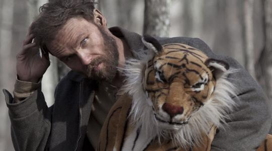Child of God (2014): Scott Haze and a stuffed tiger he won at the carnival.