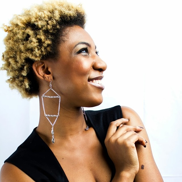 "Designer Rebekah Christie @charmedfeathers modeling ""Pyramids"". #rebekahchristie #charmedfeathers #silver #natural #earrings #jewelrydesigner #potd #nhdaily #artists #naturalhairmojo #naturalhair #accessoryoftheday"