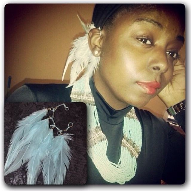#r/p @queen_dala she knows who she is. Niarra is wearing Chellise. But at  www.charmedfeathers.com  #charmedfeathers #featherearcuff #accessoryoftheday #feathers #cute #redlip #jewelrydesigner