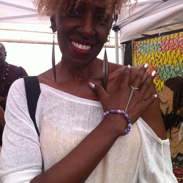 Singer Aziza wearing CF handchain at DanceAfrica.  Www.charmedfeathers.com  #danceafrica #danceafricabazaar #bam #streetfestival #fair #festival #brooklynfestival #handaccessory