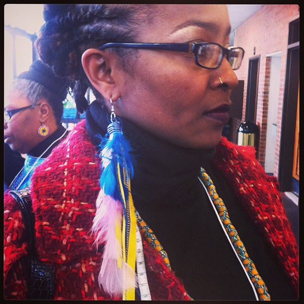All the way from New York I bumped into a woman wearing one of my first feather creations from 2009 #boss #jewelrydesigner #DC #howarduniversity #accessories