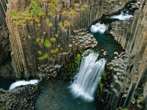 quelowat :     Litlanesfoss, Iceland   Photograph by Wild Wonders of Europe   At Litlanesfoss, the waterfall cross-sections an ancient lava flow, which formed columns as it cooled.   Via National Geographic