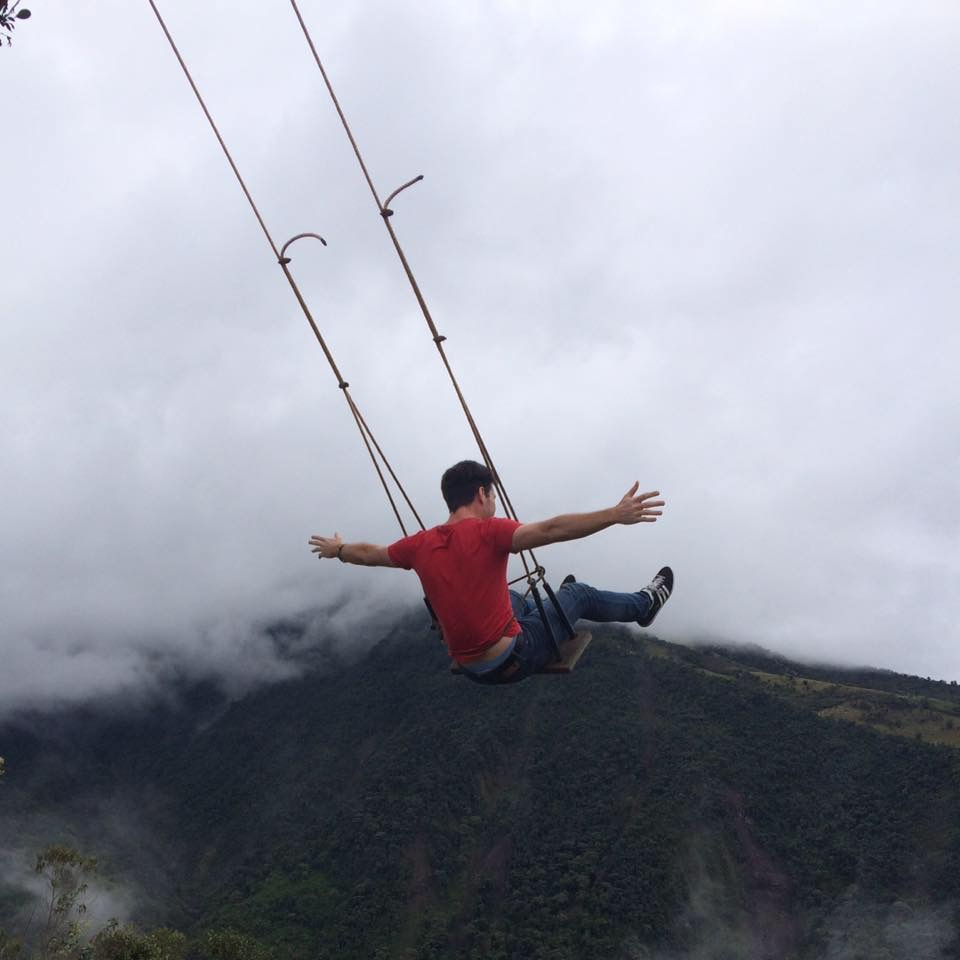 Jason swinging at the End of the World in Banos, Ecuador