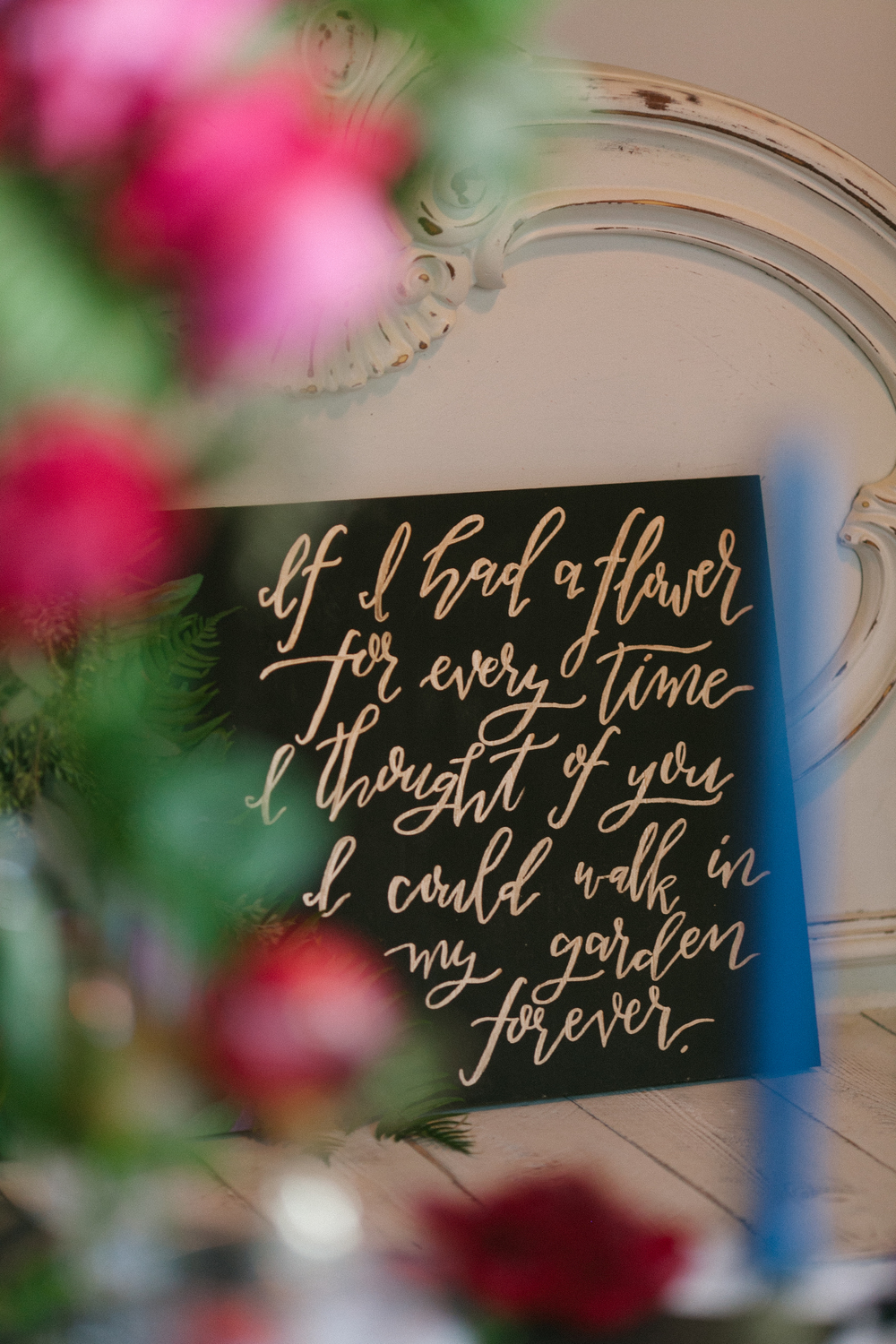 black and gold wedding signage