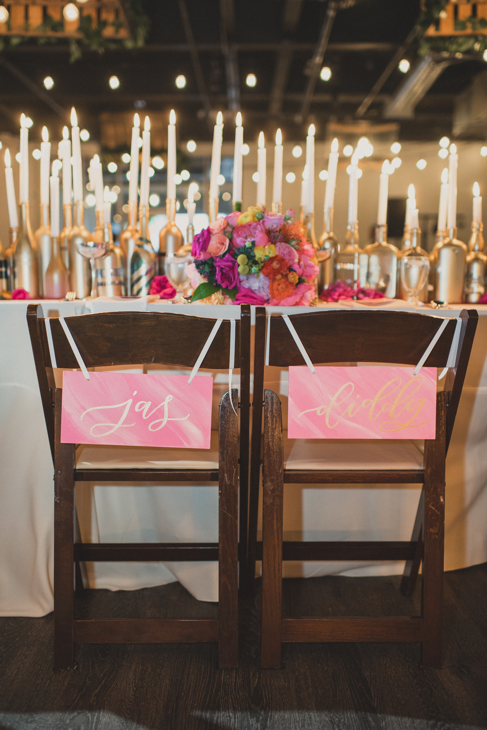Pink wedding chair signs