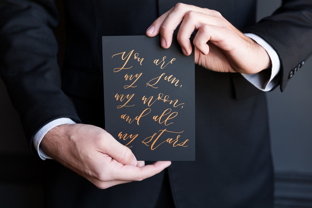 Black and gold calligraphy love quote