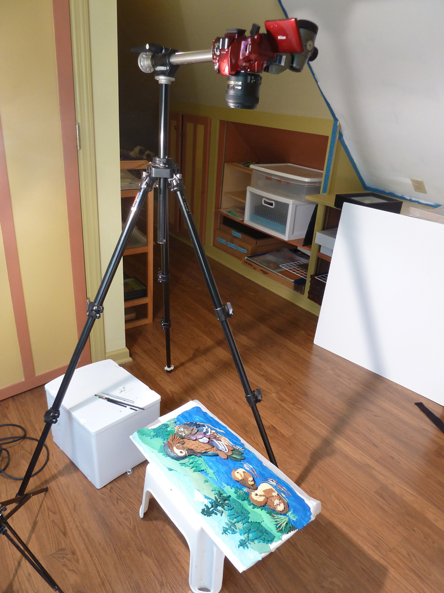 Turn to the left and you will find my teeny-tiny photo studio which is just right for hobbit sized people and clay reliefs that do not move when shot.