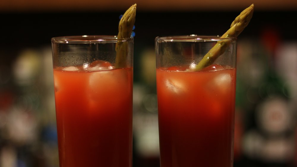 Caesar cocktails with pickled asparagus garnish