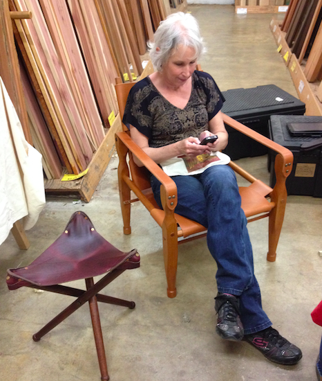 Mrs. Dowd managing Dowd Tools' social media reclining in Jason's Roorkhee chair