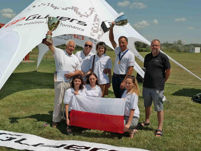 The Peszke family and dedicated employees celebrate with multi-world champion Sebastian Kawa (standing second from right) and his father Tomasz (standing far left).