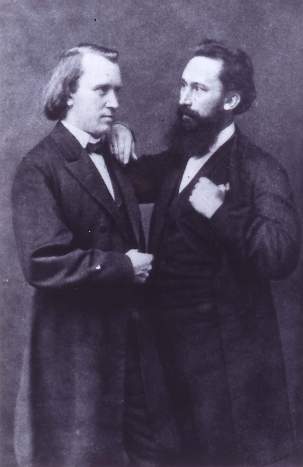 Johannes Brahms & his friend Julius Stockhausen circa 1870.   Stockhausen performed as the baritone soloist in both the successful 1868 performance of  Ein deutchses Requiem  in Bremen (in German) and in the 1871 London performance (in English).   Stockhausen also was appointed music director of the Hamburg Philharmonic over Brahms.