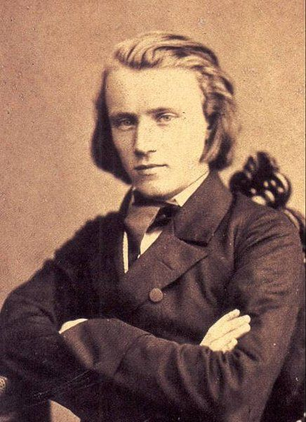 The 20-year-old Johannes Brahms appears in a photograph circa 1853, the year of Schumann's praise for him in the  Neue Zeitschrift für Musik.