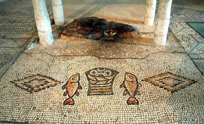 The stone altar and the mosaic of the fish and loaves of bread in the Church of the Miracle of the Multiplication of the Loaves and the Fishes at Tabgha.                           Photograph: Yael Alef 2007