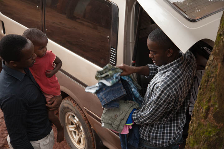 Godfrey distributing clothes.jpg