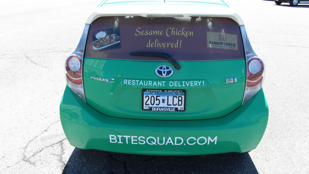 Restaurant specific promotions on vehicle wraps.