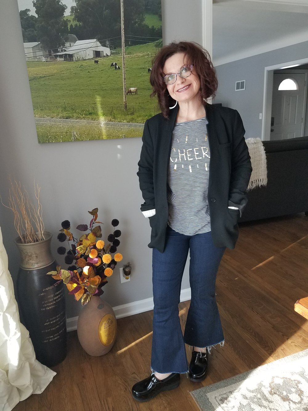 It was a warm January day so I broke out one of my favorite jean/pant silhouettes - cropped flare - and paired them with a simple black blazer and graphic tshirt.  On my feet?  My Dansko clogs of course.