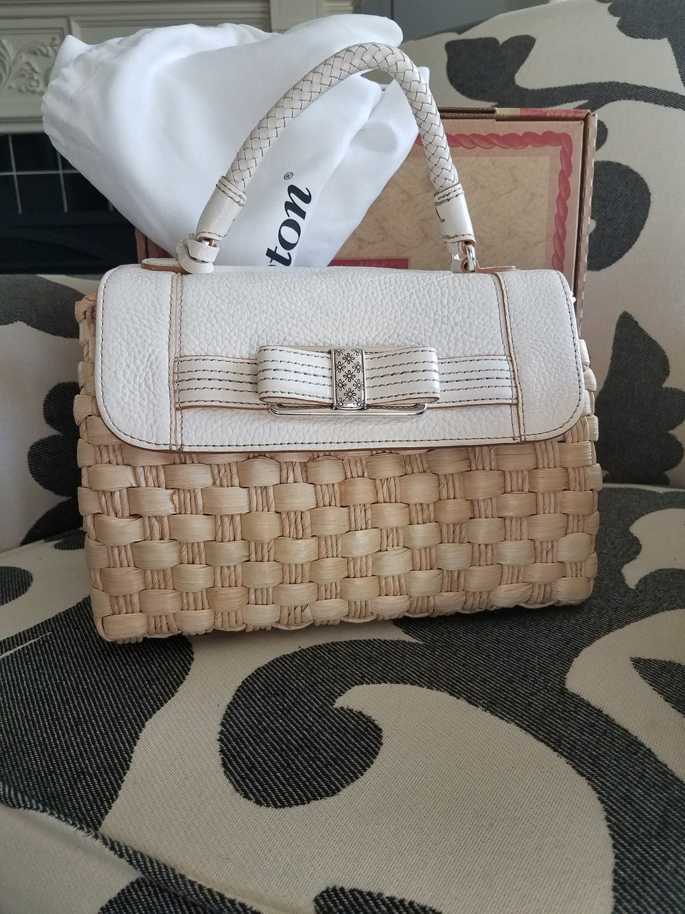 Straw Bag - Classic styling, neutral leather trim, and silver hardware make this a great versatile straw handbag.