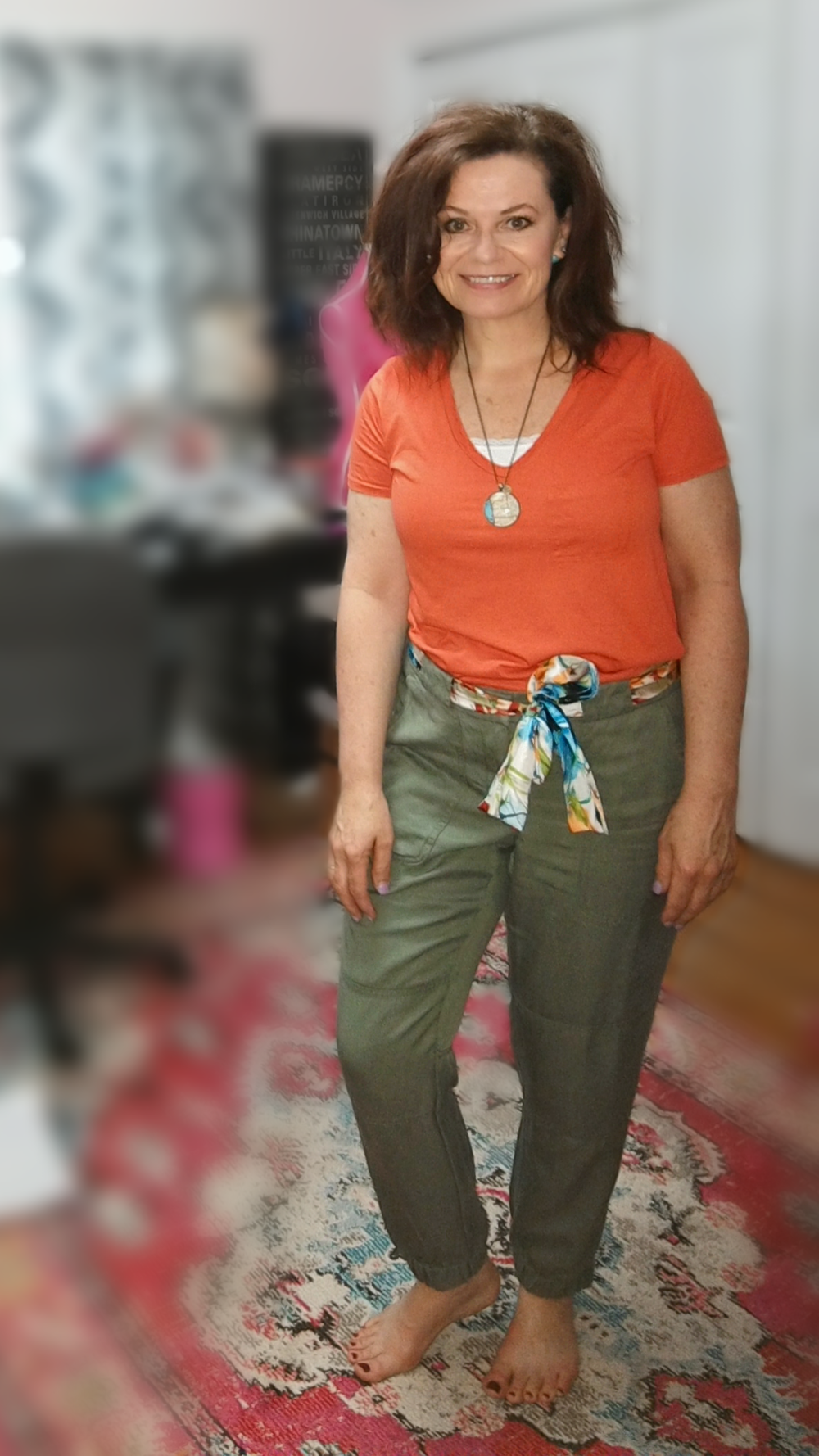 Add Color with your top and Neutral bottom - Simple orange tshirt paired with khaki green pants.  The belt adds some extra color but also ties the whole color palette together (I love the scarf-as-a-belt thing).