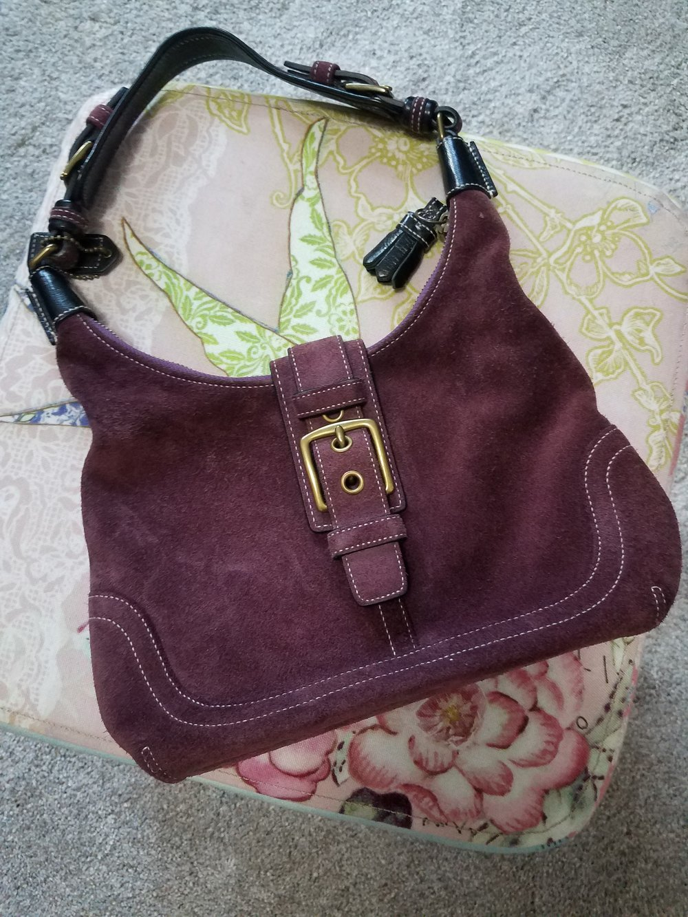 Coach Purple Suede Mini - My husband bought this for me for my birthday some time ago.  As is usually the case with Coach handbags, this beauty continues to be perfect regardless the year.  What I love:  the color, the suede, the hardware, the leather trim.  Everything really!