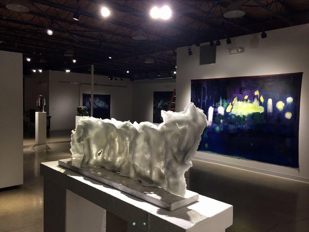 "Katherine Rutecki,  Cloud Extension,  Pate-de-verre, stone, 102x18x43cm, 2018  feat: Jon Witzky,  Wedding Party,  Oil on Canvas, 84""x120"", 2017"