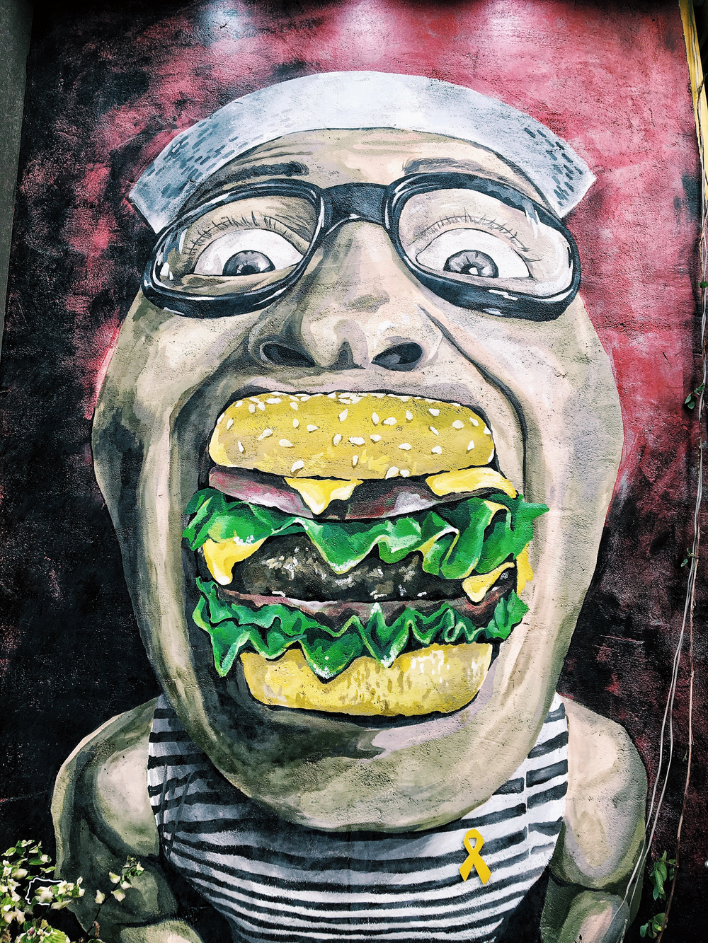 I'm guessing this mural depicts the guy in charge of the burgers.