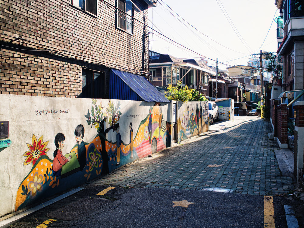 A street with murals.