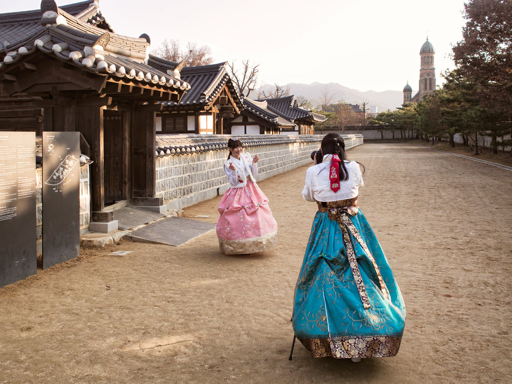 Tourists taking pictures of themselves in Hanbok.