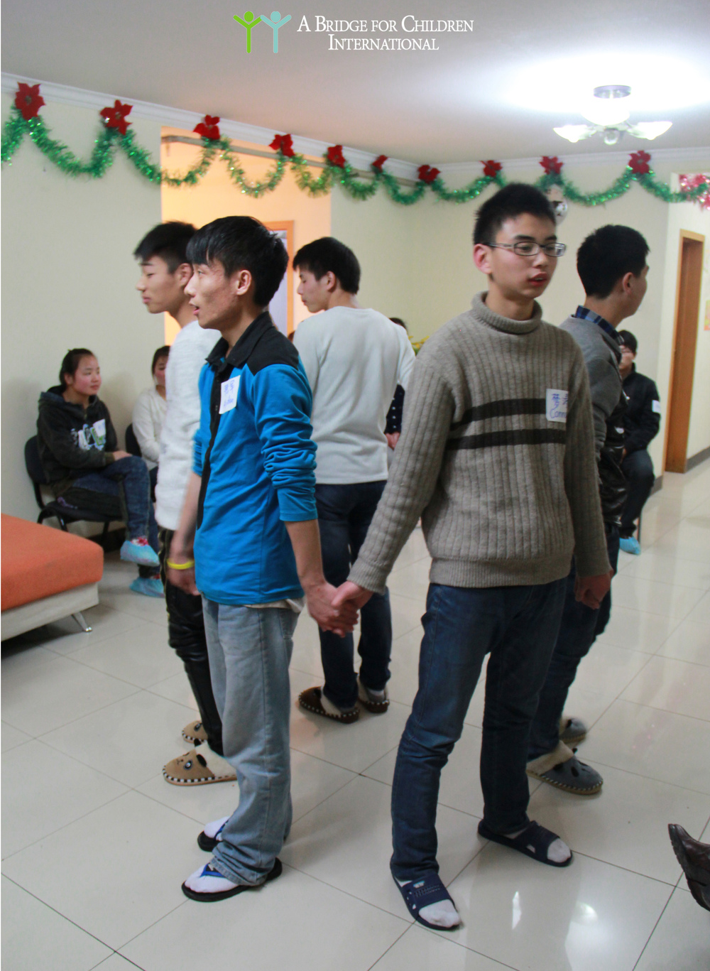 The boys' performance at the 2013 DREAM Christmas Party, celebrated alongside ABC staff and former DREAM students.