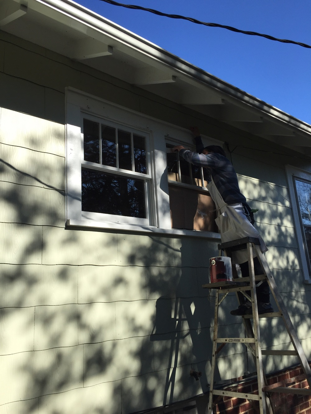 Here Mikey is applying the finish coat of Benjamin Moore aura, making it look easy.