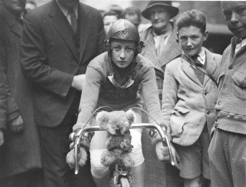 Close-up of Billie Samuels on the Malvern Star bike showing her koala bear mascot before leaving for Melbourne