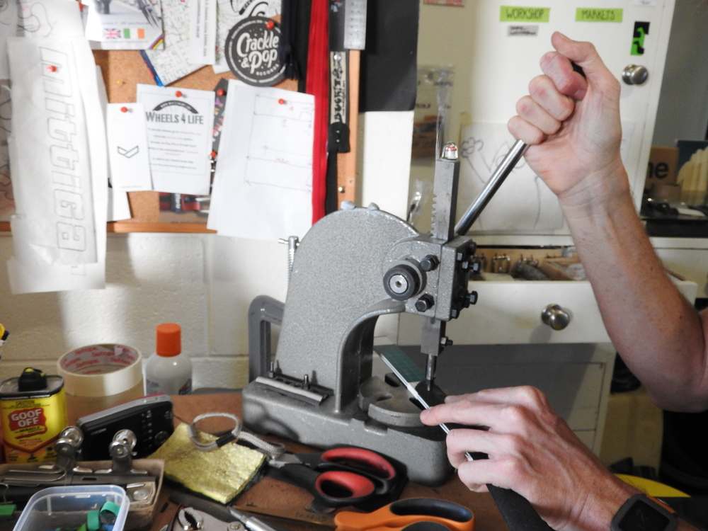 Scissors and a metal punch are the only mechanical help Craig uses.