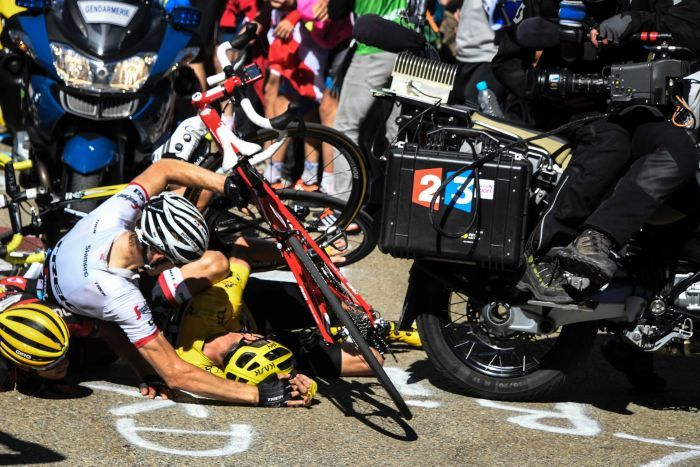 "This scene was caused by alleged ""fans"" of cycling. Credit: AFP Photo / Pool / Bernard Papon"