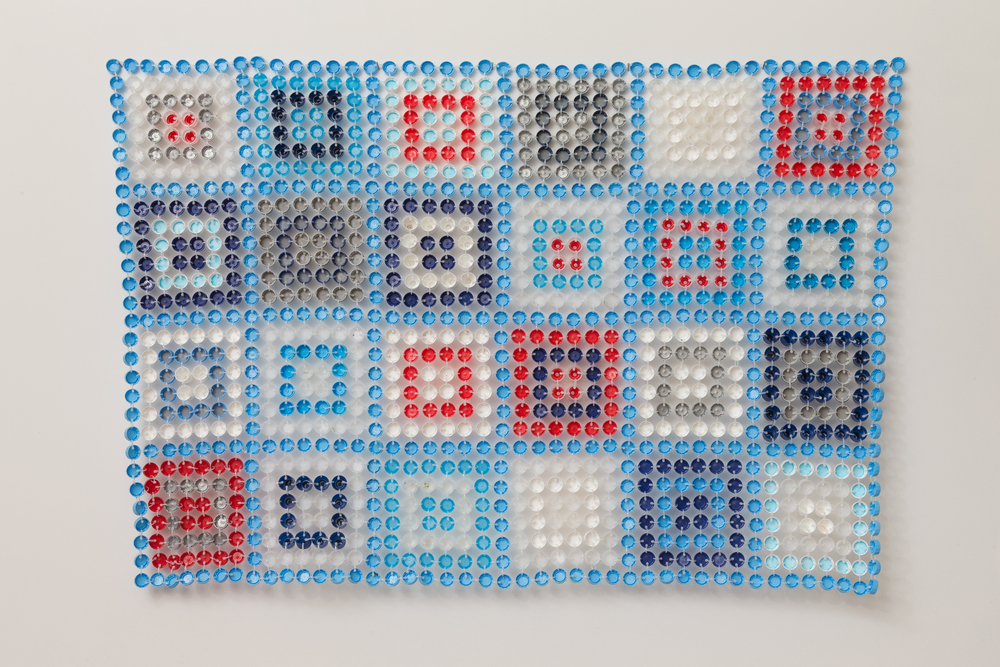 Aunty Jinnie   2014  Plastic bottle caps & cable ties  110 x 160 x 1cm  photographer James Field, courtesy of Adelaide Central School of Art