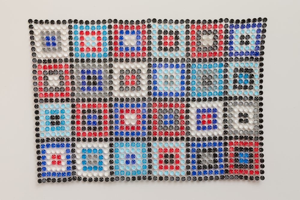 Aunty Winnie   2014  Plastic bottle caps & cable ties  110 x 110 x 1cm  photographer James Field, courtesy of Adelaide Central School of Art