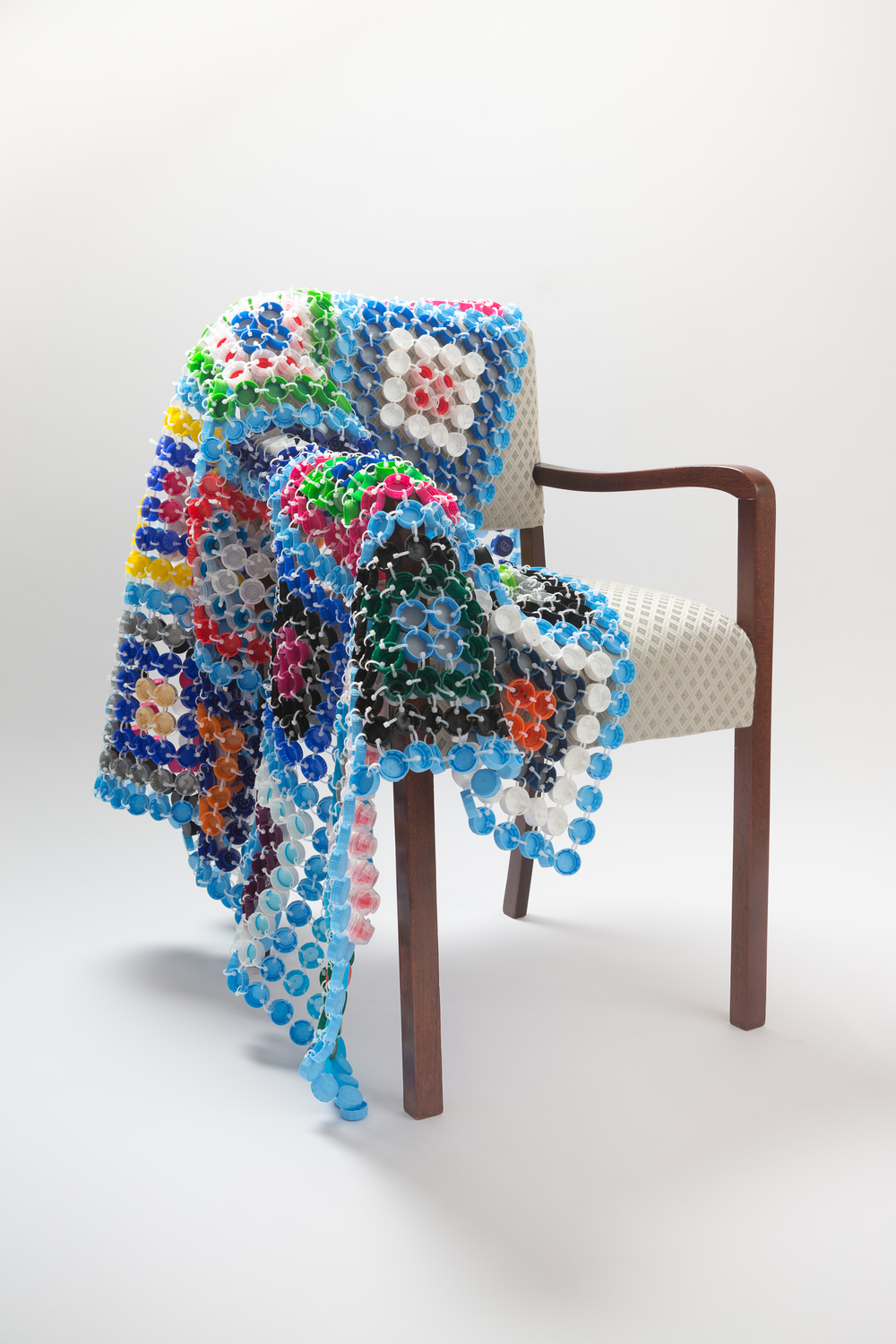 Big Nana   2014  Chair, plastic bottle caps & cable ties  90 x 60 x 60cm  photographer James Field, courtesy of Adelaide Central School of Art