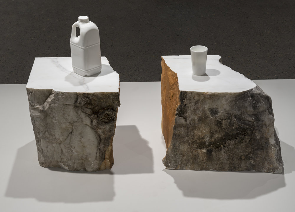Half , 2013, Statuario marble, 315 Duralex glasses and dust from the carving, two pieces: 56 x 39 x 55 cm and 73 x 39 x 40cm.