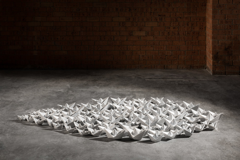 Paper Armada  2015, Bianco Carrara marble, 100 pieces, largest 12 x 25 x 12 cm to smallest 6 x 12 x 6 cm each (installed dimensions variable)