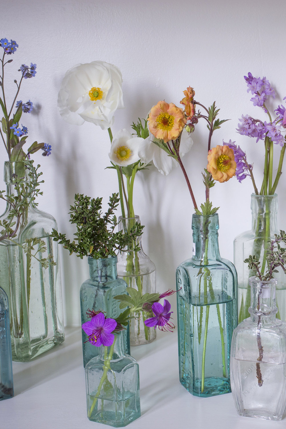 Glass bottles and flowers | Aesme Flowers London