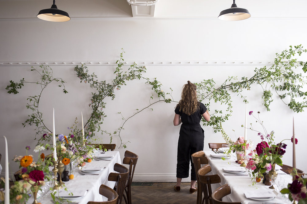 A  & J  |  J U N E - A celebration of the garden in June and all things British with a wild rose installation and fruit and flower tablescape at St John Bread & Wine, Spitalfields