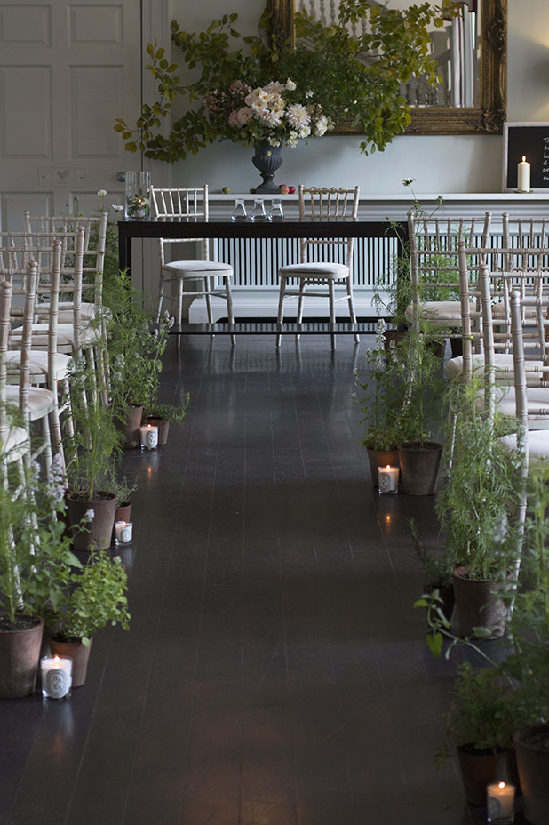 The aisle was lined with terracotta pots of scented herbs and flowering cosmos plants