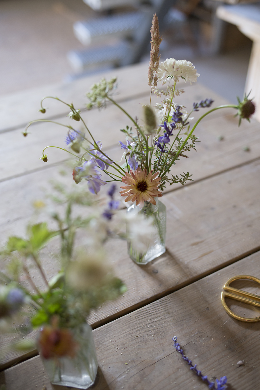 Intricate buttonholes woven with delicate garden flowers, sprigs of fragrant lemon thyme and tiny strawberries