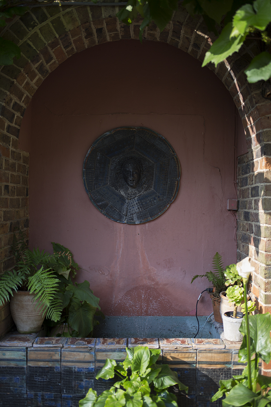 The courtyard fountain at Tilton House with original ceramics decorated by painter and textile designer Duncan Grant.