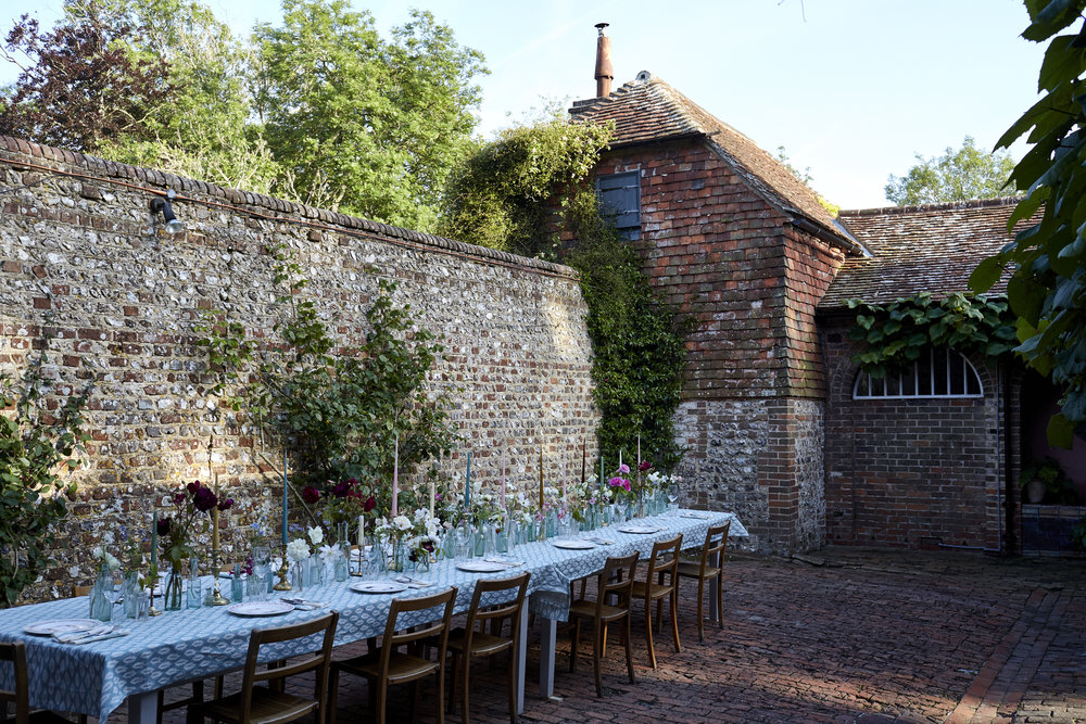 Seasonal summer suppers in the beautiful walled courtyard garden beneath the dovecote. We will demonstrate and collaboratively style a tablescape with garden flowers and plants, framed by a backdrop installation for the final night's supper. Image by Kristin Perers.
