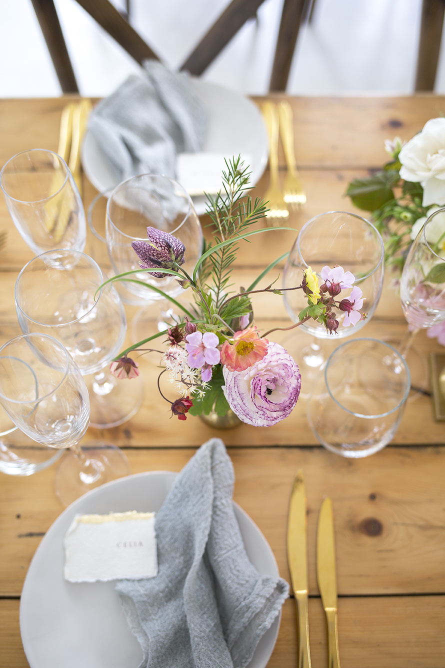 The reception dinner took place on the floor above, with long trestle tables, clustered brass vessels of seasonal flowers from the farm and the dancing flames of dusky pink tapered and pillar candles.