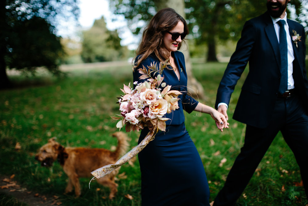Our very own Jess, with Ben and Mavis in Hyde Park after her Marylebone wedding in September. Her bouquet flowers, in a palette of peach, copper and tiny specks of lilac, were all cut from the garden and included 'Julia's Rose', rose 'Perle D'Or', elder, bunny tail grasses and asters, tied with a heavily embroidered silk ribbon. Photographed by  Naomi Goggin