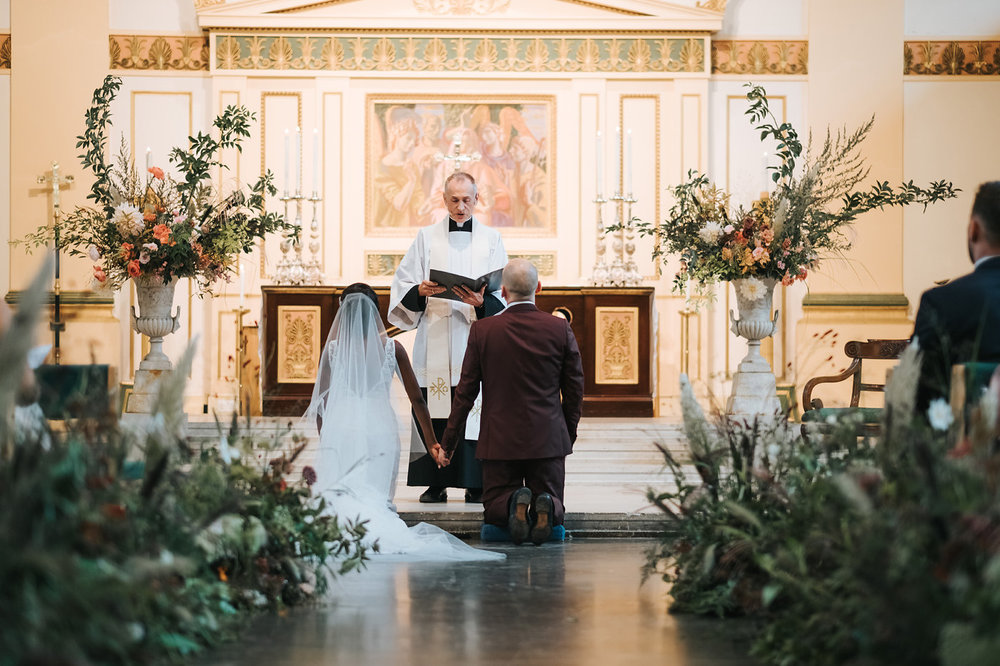 The aisle at St Johns, Waterloo flanked by 24 metres of foliage runners - we used lots of ferns and grasses to create a textural base, then threaded through a few delicate headed flowers and umbels of wild carrot. Photographed by  Miss Gen