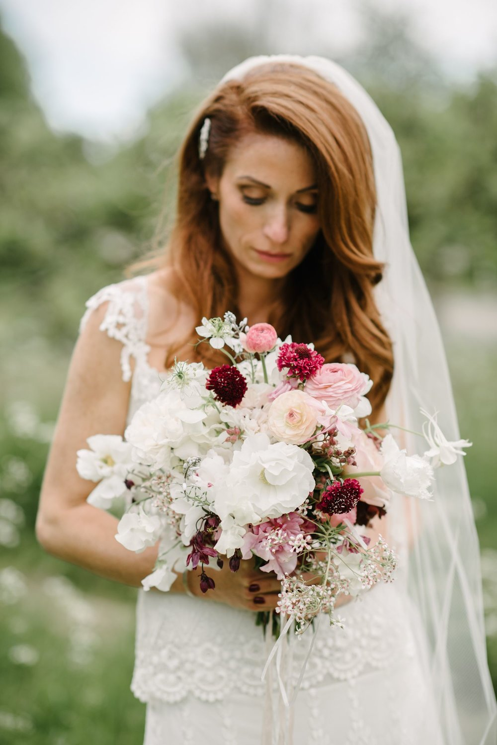 A palette of snow white and clustered accents of pale pink to a sumptuous maroon red. Photographed by  Dominique Bader Photography