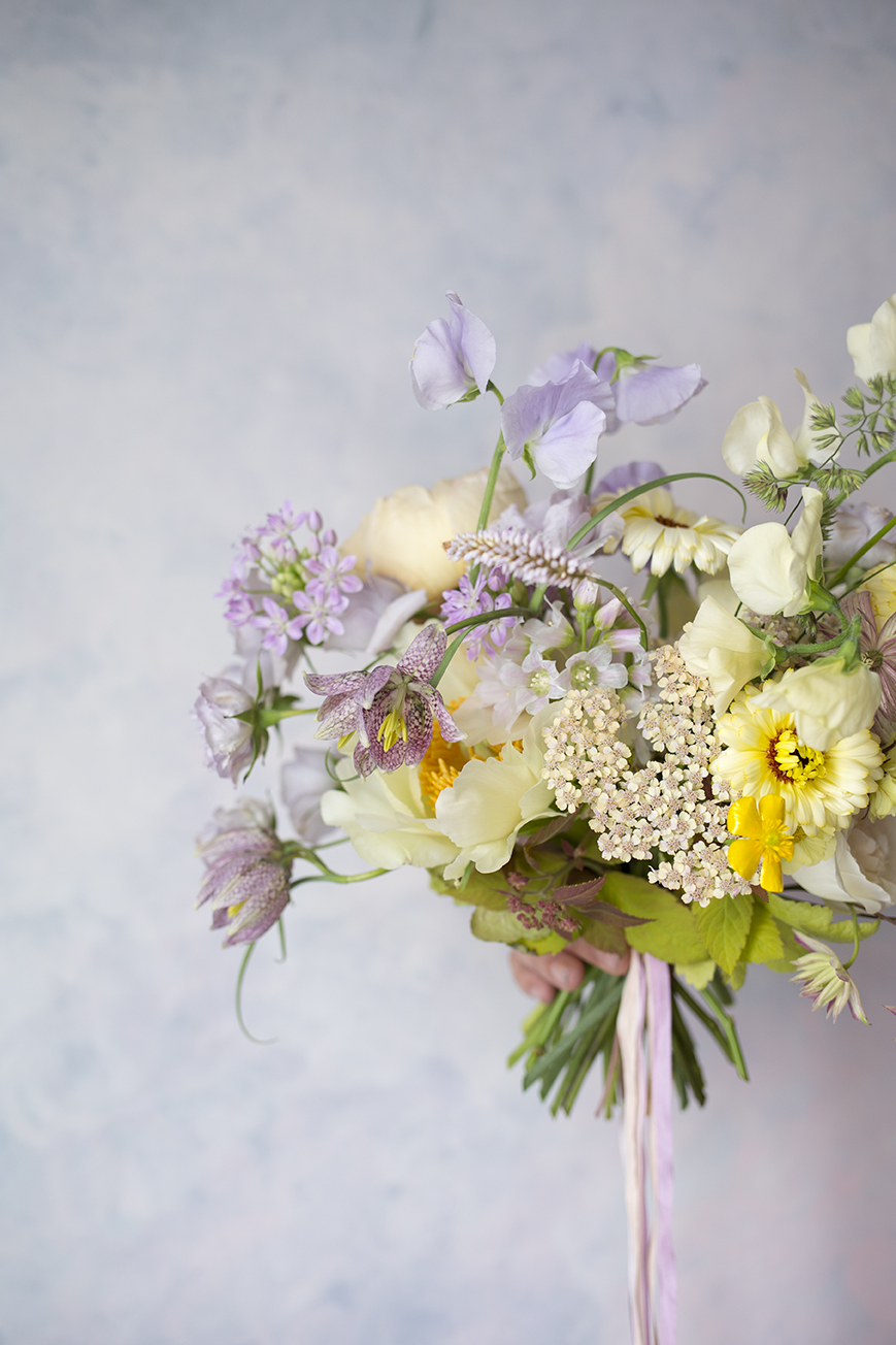 A spring wedding bouquet with fritillaria made by a student at a private class at Aesme Flower Studio
