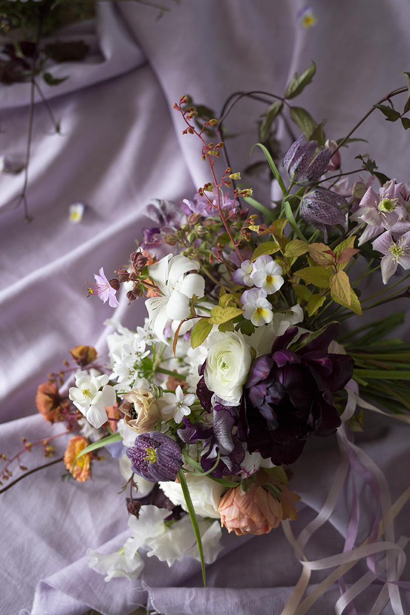 A spring wedding bouquet with pansies made by a student at a private class at Aesme Flower Studio