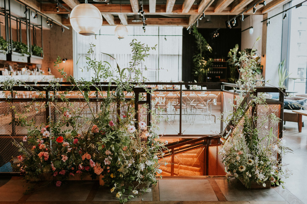A 'garden border' installation to the staircase at  The Kitty Hawk  in the City. Photographed by  Maja Tsolo